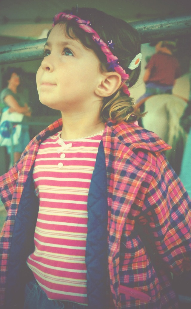 This is one of my favorite photos of my daughter at the age of four. Emma Rose was staring up at a ride at the county fair with wonder in her eyes.